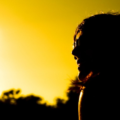 Girl in a sun silhouette iPad Wallpaper
