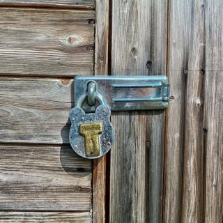david mark - hanging lock wooden door ipad wallpaper