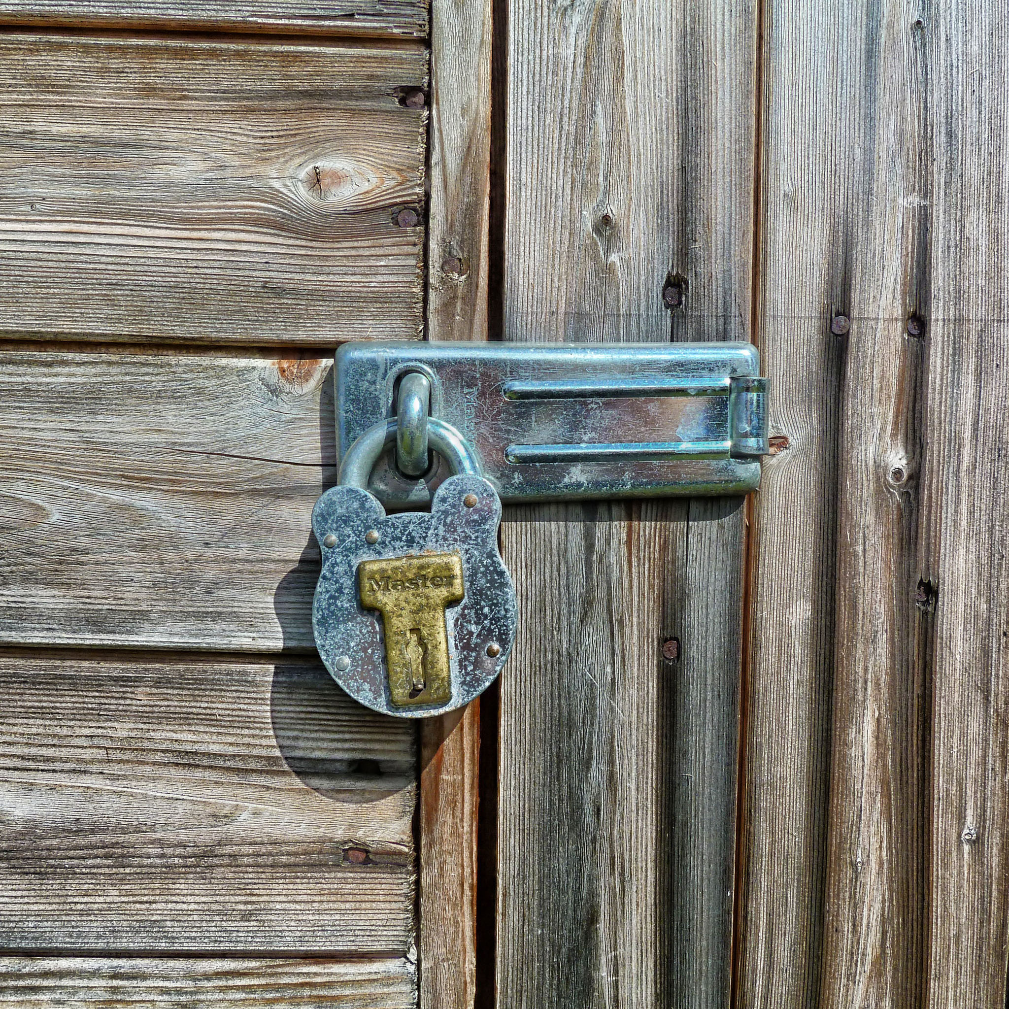 david mark - hanging lock wooden door ipad wallpaper