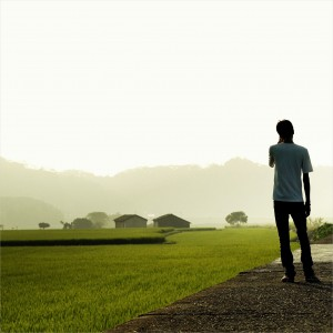 eliot. - man standing next to field ipad wallpaper