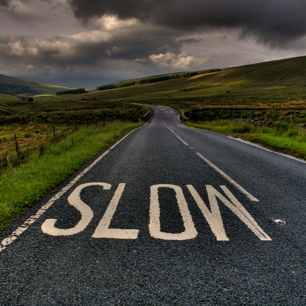 fatboyke - slow down sign on the road ipad wallpaper