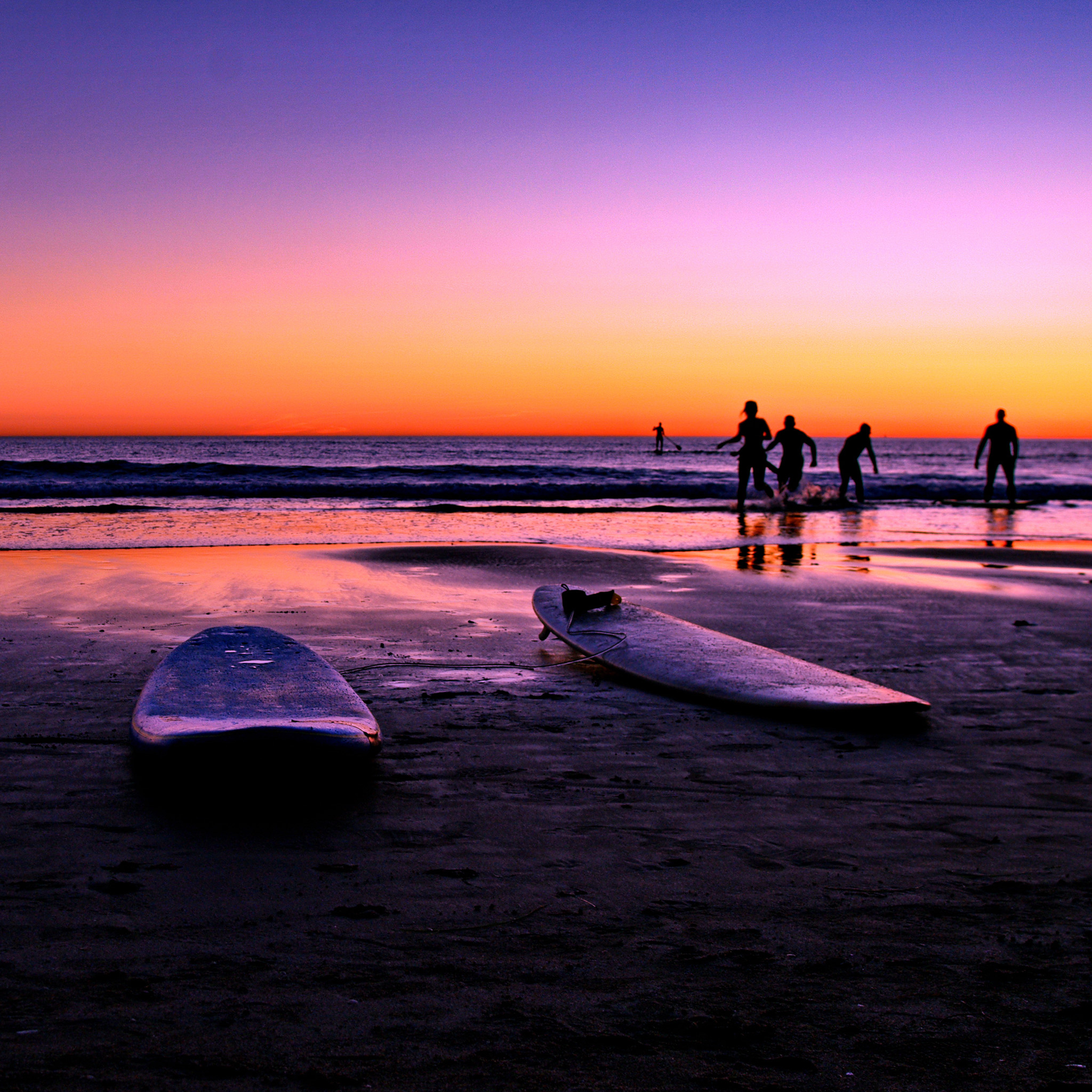 surfers at sunset ipad wallpaper